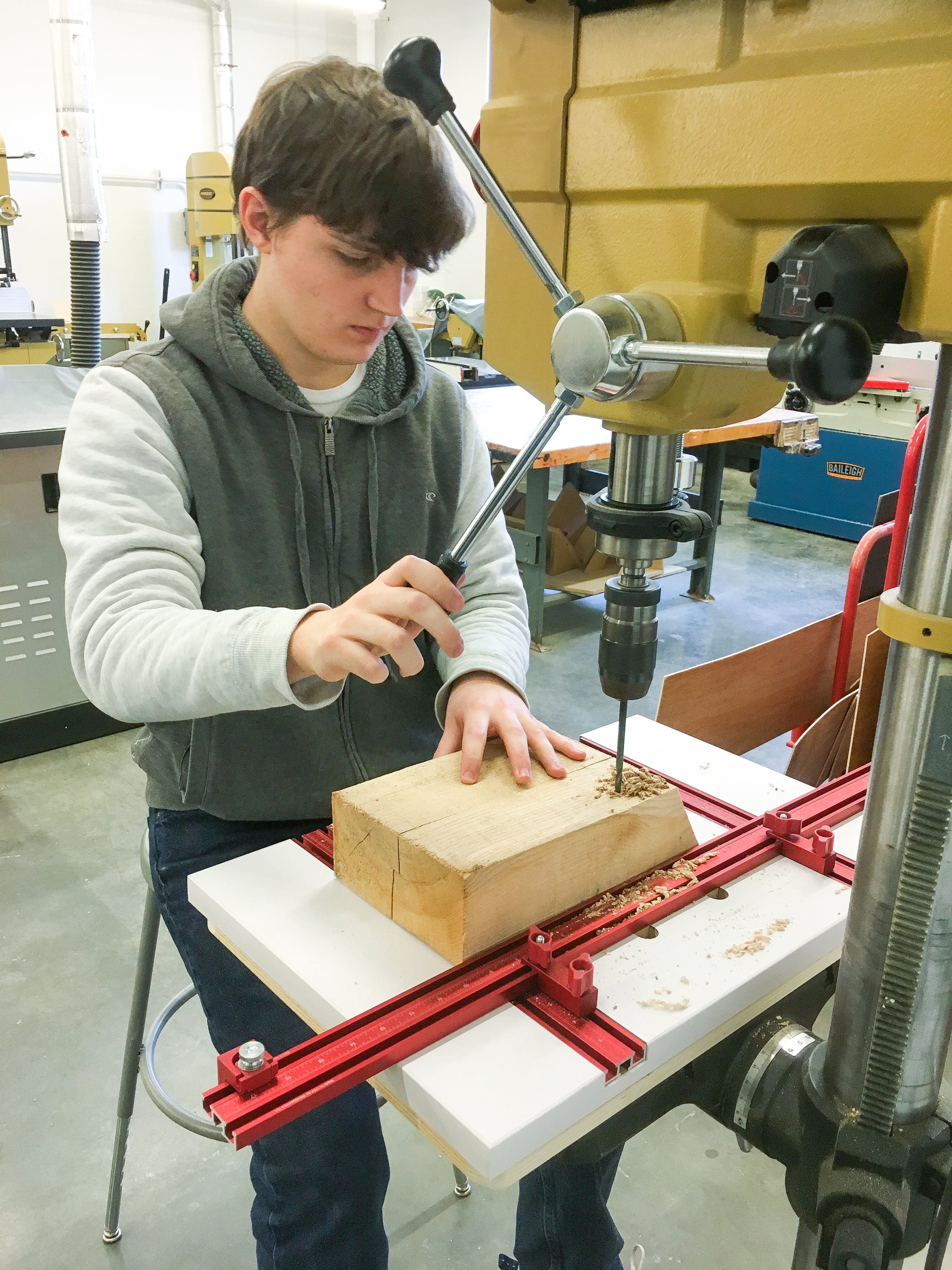 Sam Mackintosh-Smith begins to drill holes in a bee block.