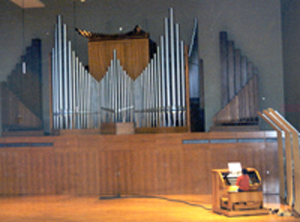 Pipe organ with console on stage