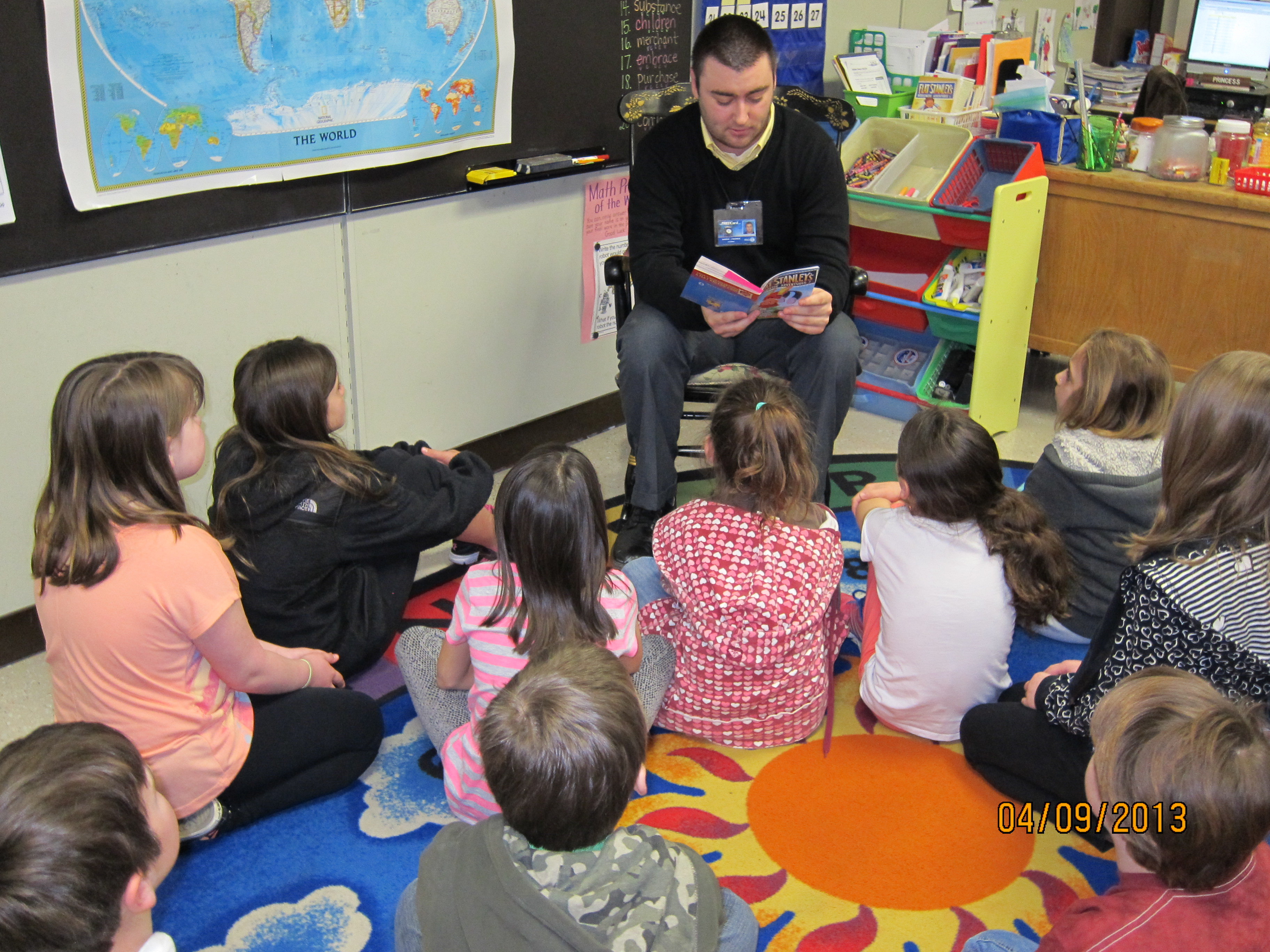 Teacher candidate reading to students