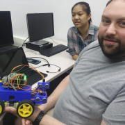 Students work on self-directing robots