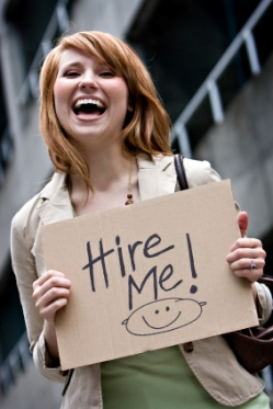 "Young Woman with ""Hire Me"" Sign"