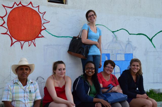 students and mural in Oaxaca