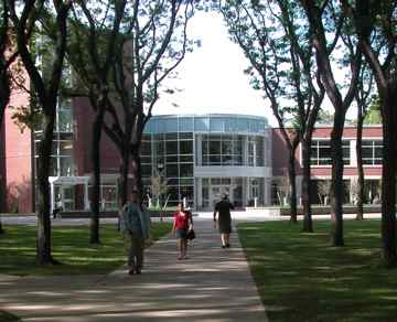 Walking across campus toward Univeristy Commons/FSA Bookstore