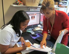 Ms. Skemer assists Natselyne with her course schedule