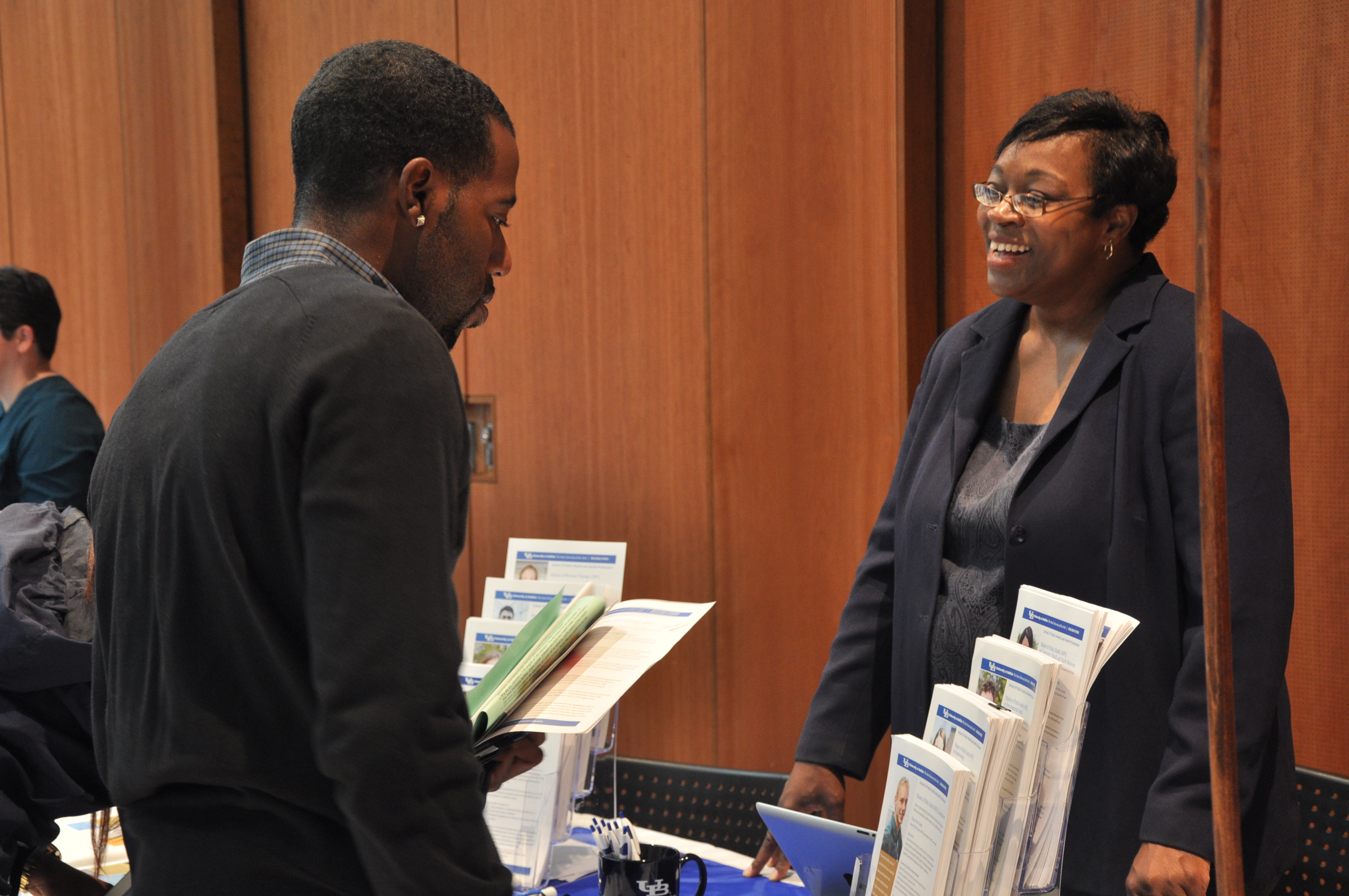 Prepare for Graduate School - Student interacting with a recruiter at the fair