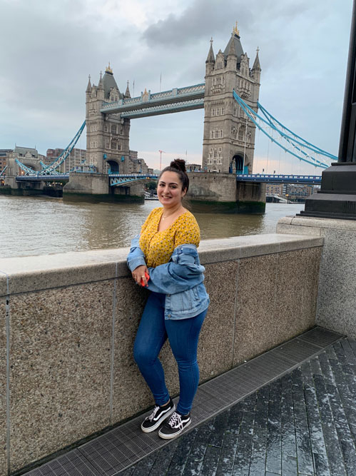 student standing in front of Tower Bridge in London