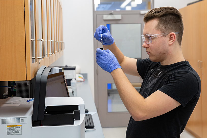 Kevin Aumiller works in a lab in the Science Center.