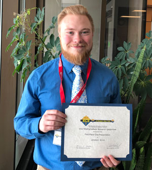Alexander Green, with Oral Presenter certificate,