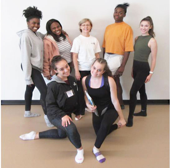 Dance students and faculty member