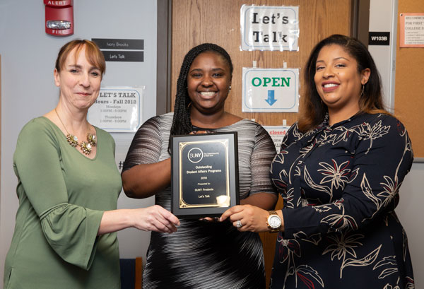 Proudly displaying Fredonia's SUNY Outstanding Student Affairs Award plaque are (from left): Director Tracy Stenger and Ivory Br