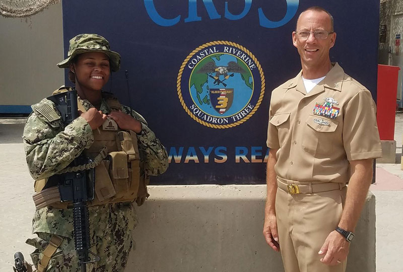 Petty Officer Electronics Technician 2nd Class Heaven Rollek with U.S. Navy Reserves Senior Chief Jeff Walter.