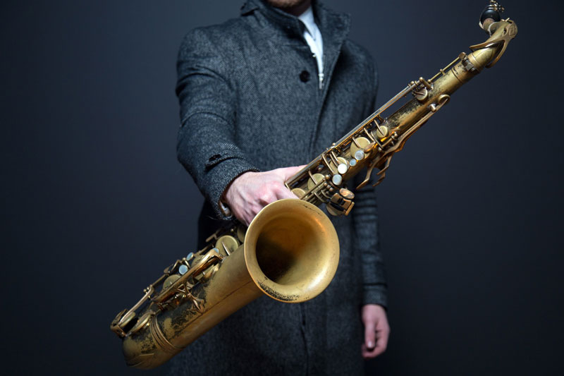 picture of musician holding saxophone