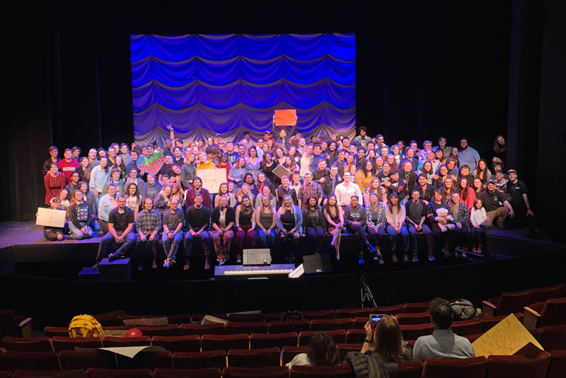 cast, faculty and staff of musical on stage