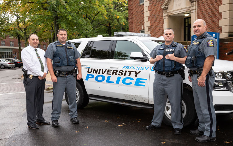 Police offers next to cruiser