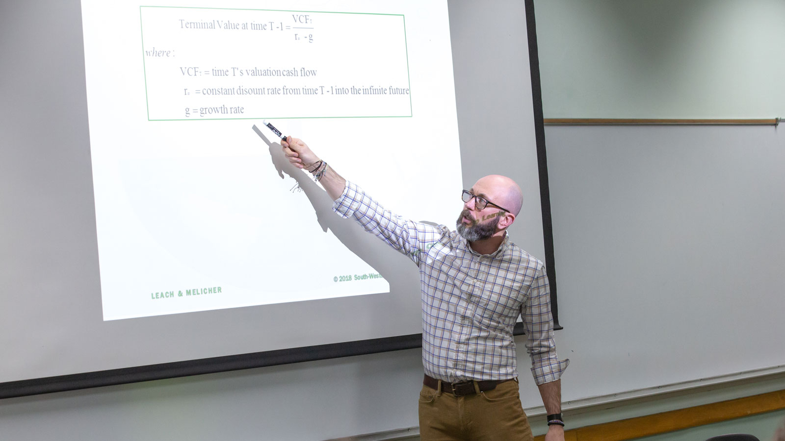 Finance professor teaches class