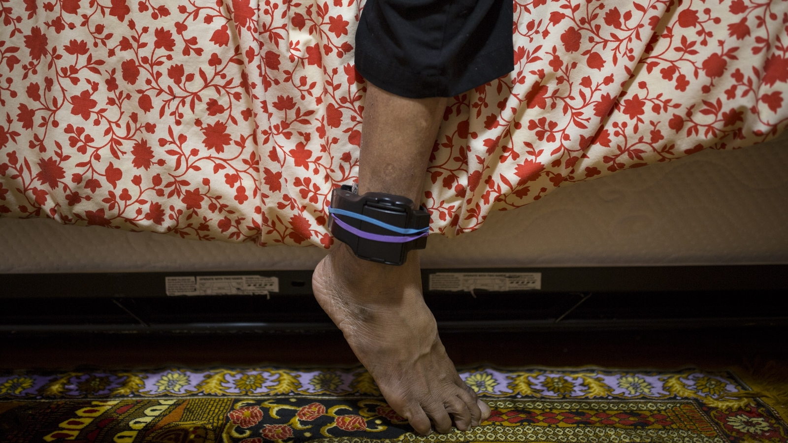 While living in Sanctuary, Sujitmo Sajuti, ankle monitor, Unitarian Universalist Church, Meriden, Connecticut, from the series Living in Sanctuary by Cinthya Briones-Santos