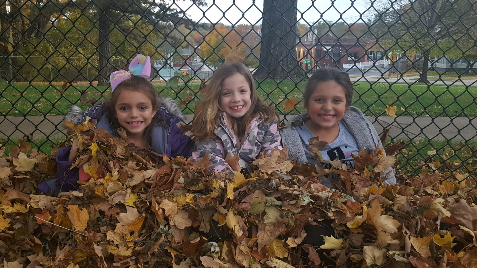 After school program playing in the leaves