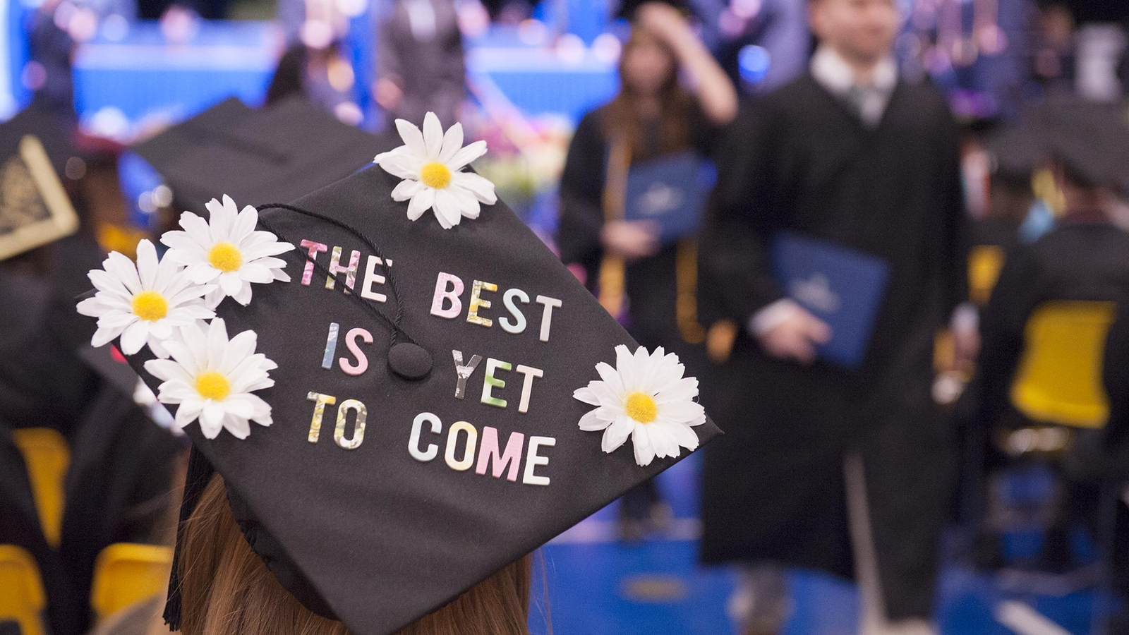 "a hat at commencement that reads ""the best is yet to come"""