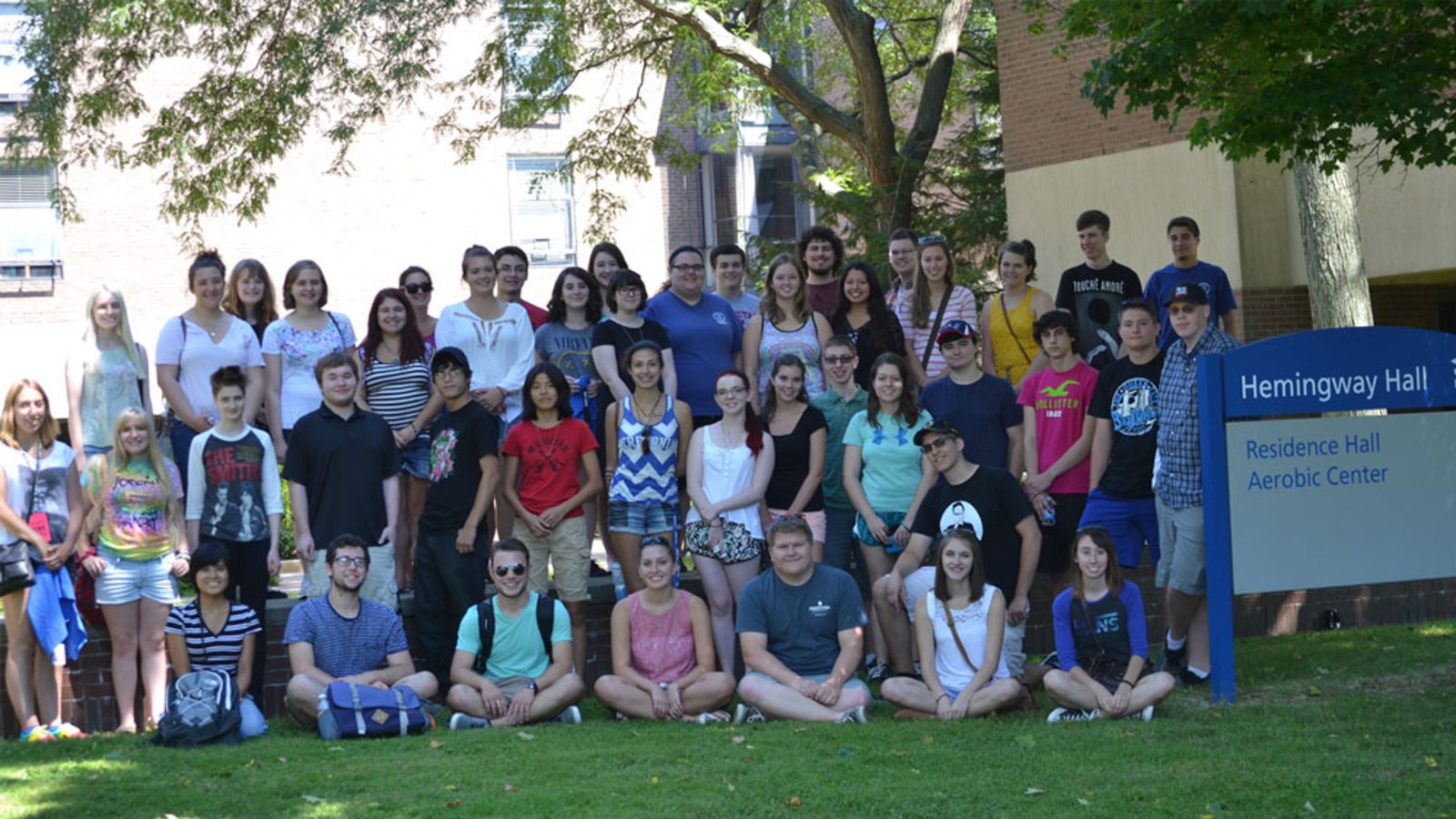 honors students pose for photo outside Hemingway Hall