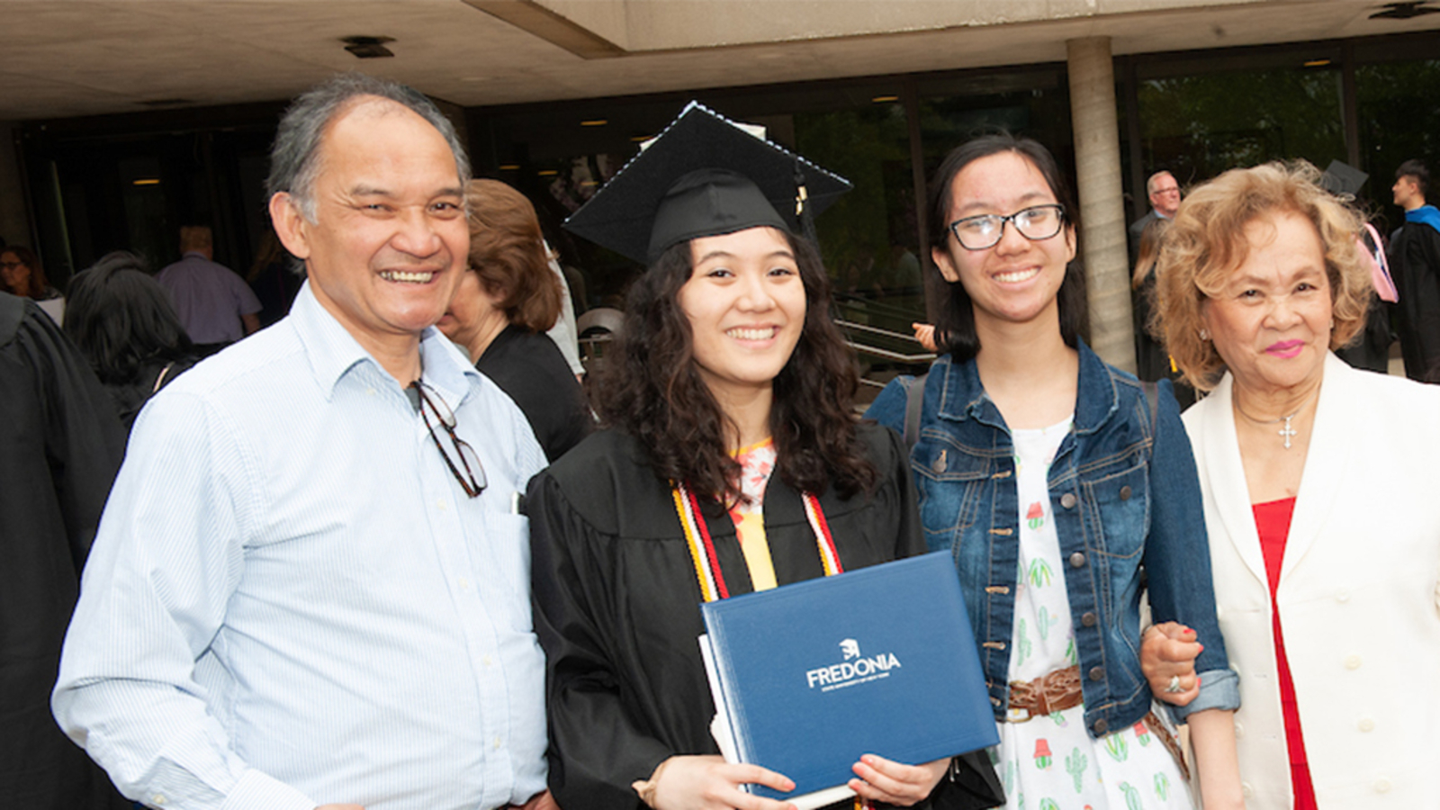 a family poses for a photo at commencement