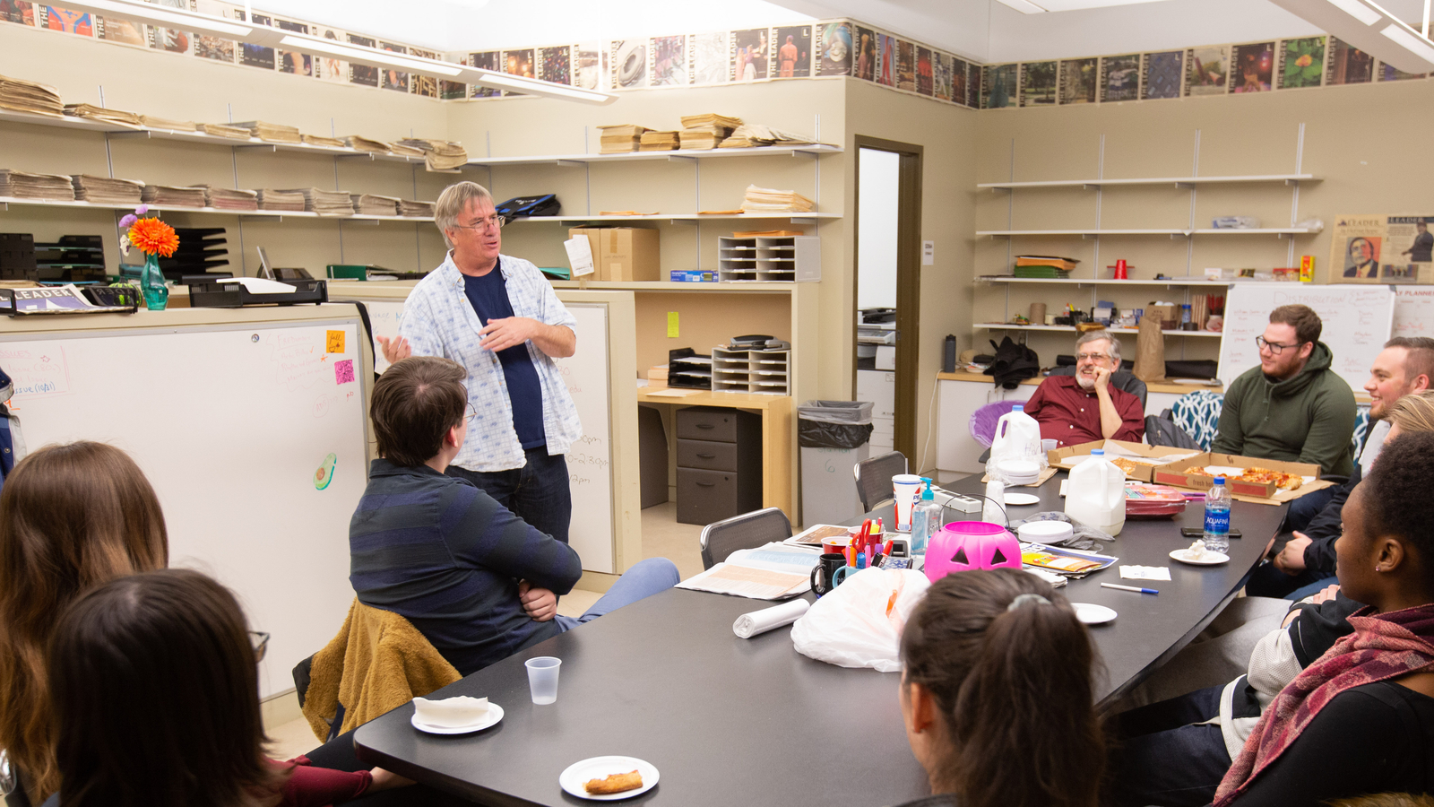 Scott Martelle, '84, works with students at The Leader newspaper