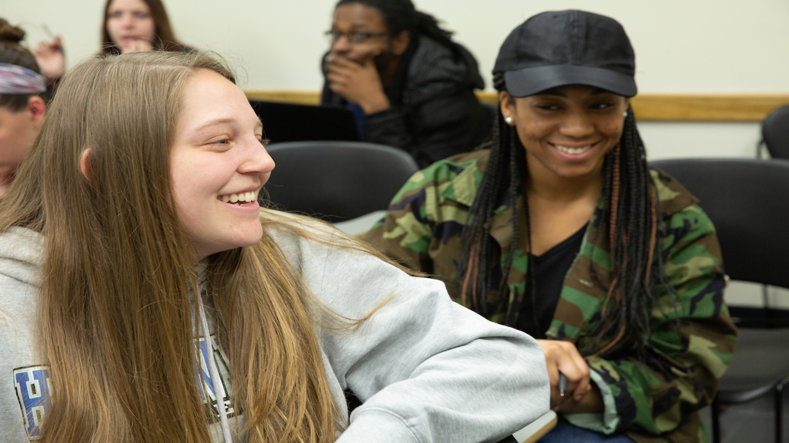 Students engage in lively discussion during Communications class.