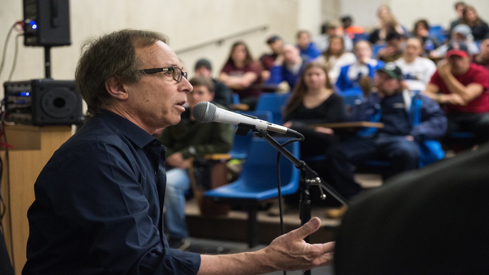 A guest speaker addresses music industry students during class