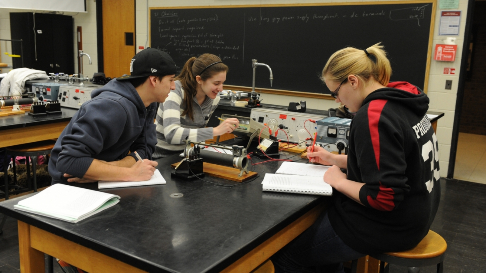 physics students work on a project