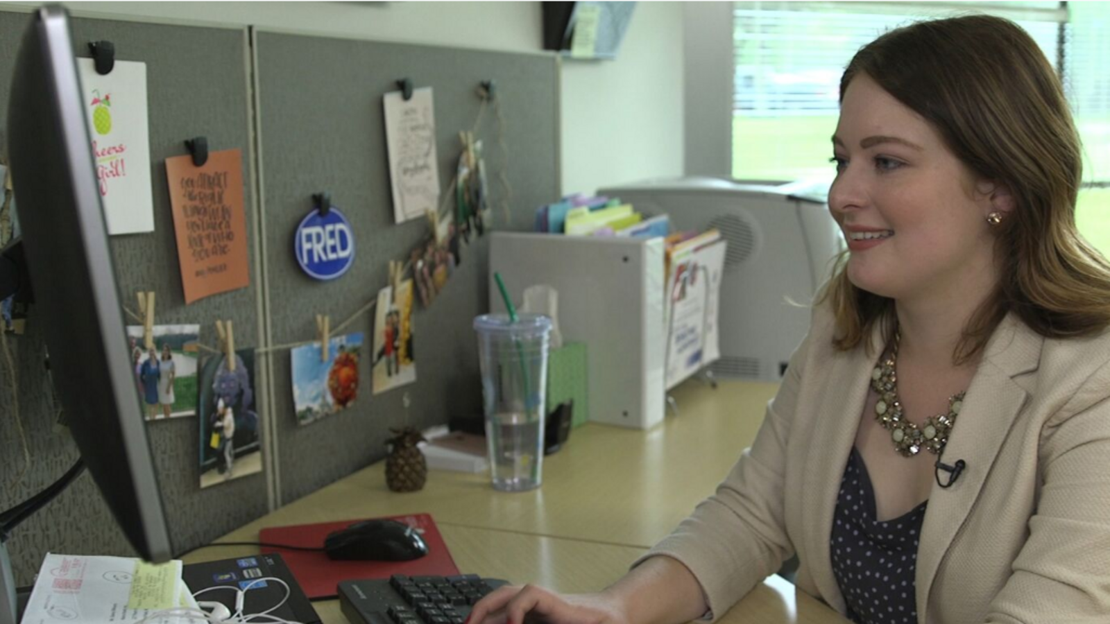 Fredonia alum Lauren Orlowski works on her job in her office