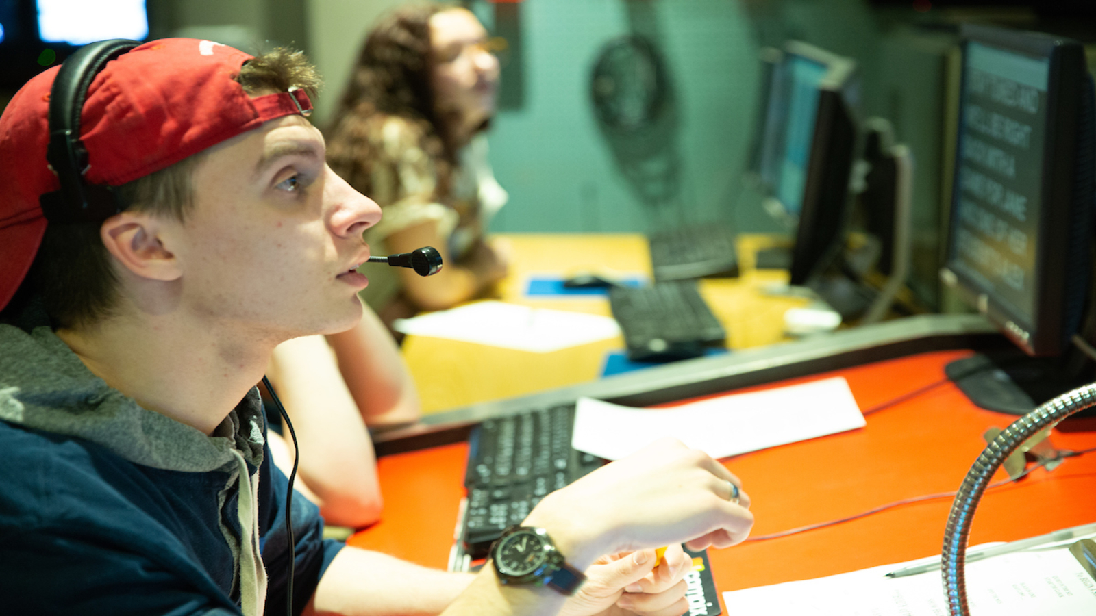 a student directs a production in the Thompson TV studio