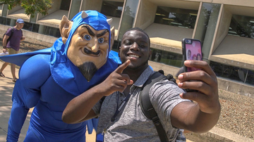 student with Blue Devil mascot