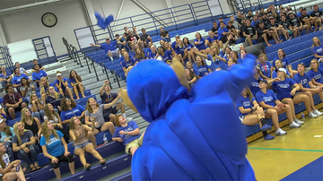 Fredonia mascot tosses gifts into bleachers toward students