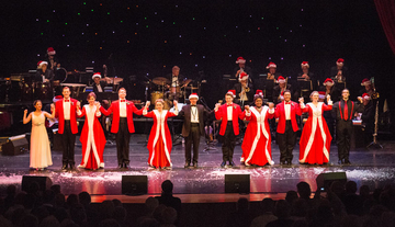 singers in Christmas costumes