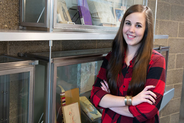 Catherine Oag, outside of the archives in Reed Library, where she is serving an internship.