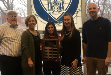 Student of Month recipient with staff