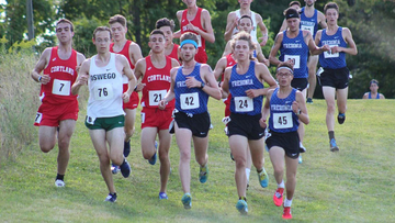The men descend a hill at the 2019 Fredonia State Invitational (photo by Megan Moellendorf)