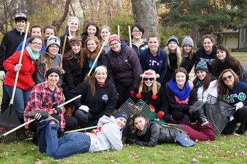 picture of students and lawn rakes