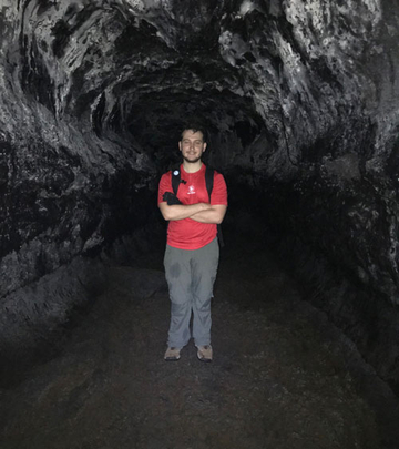 geology student in a cave