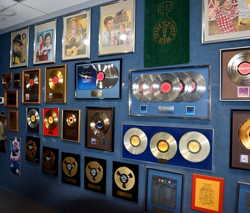 gold records hanging on a wall