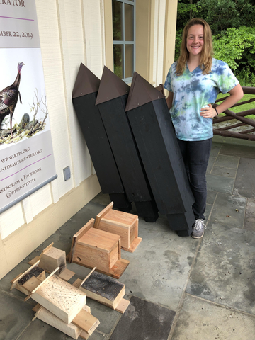 Jessica Schimek, with completed bee blocks, squirrel nests and bat houses