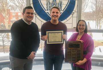 Nolan Ahearn, recipient of the November Student of the Month award, with Patrick Toscano and Kate Huff.