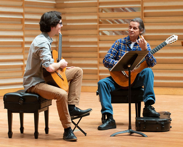 William Jenney with Luis Zea at a master class.
