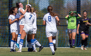 The Blue Devils celebrate one of their seven goals