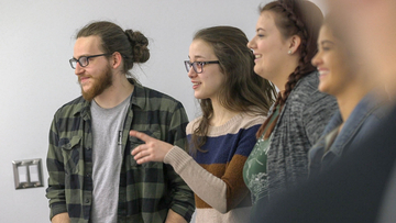 students engage in a classroom discussion