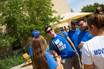 A group of students converse outside Williams Center