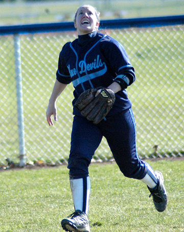 Hall of fame softball player Heather Mercer tracks down a fly ball during a game