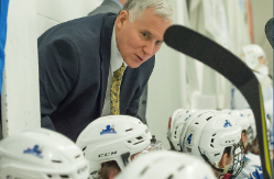 hockey coach Jeff Meredith instructs his players during a game