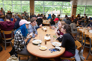 students eat lunch in Cranston Marche