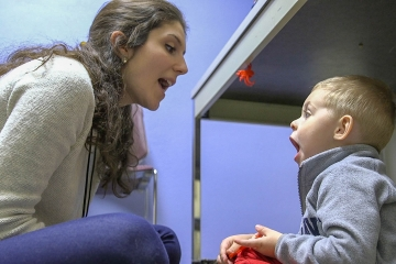 a student works with a young client on speech exercises