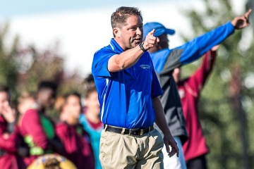 fredonia coach on sidelines of a soccer game